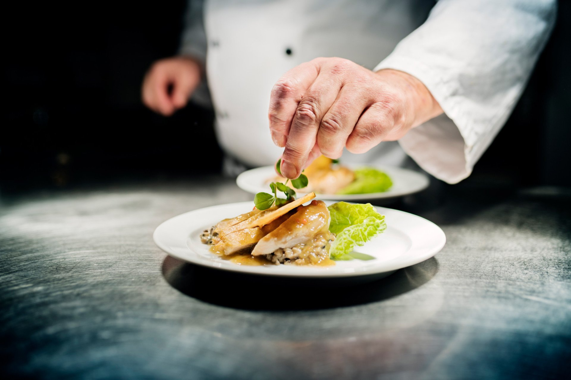 A Chef plating up a meal