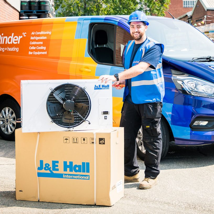 Pinder Cooling engineer installing J&E Hall Air Con Unit