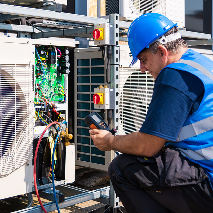 Engineer maintaining air con units